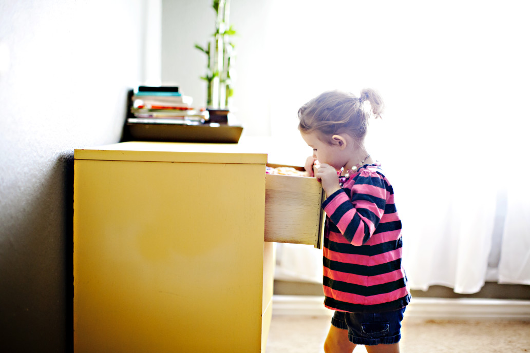 child looking in dresser for clothes